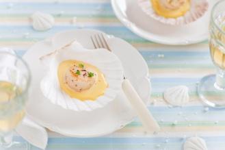 Scallops with saffron sauce on seashell